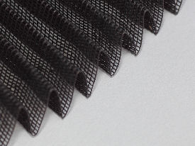 Woven and pleated synthetic mesh